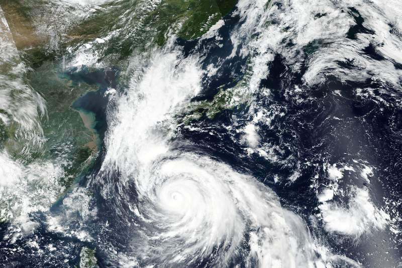 This Saturday, Sept. 5, 2020, satellite image released by NASA Worldview, Earth Observing System Data and Information System (EOSDIS) shows Typhoon Haishen barreling toward the Okinawa islands in southern Japan on Saturday, prompting warnings about torrential rainfall and fierce wind gusts. Weather officials have cautioned about Typhoon Haishen for the last several days, urging people to brace for what could be a record storm and be ready to take shelter and stock up on food and water. (NASA via AP)