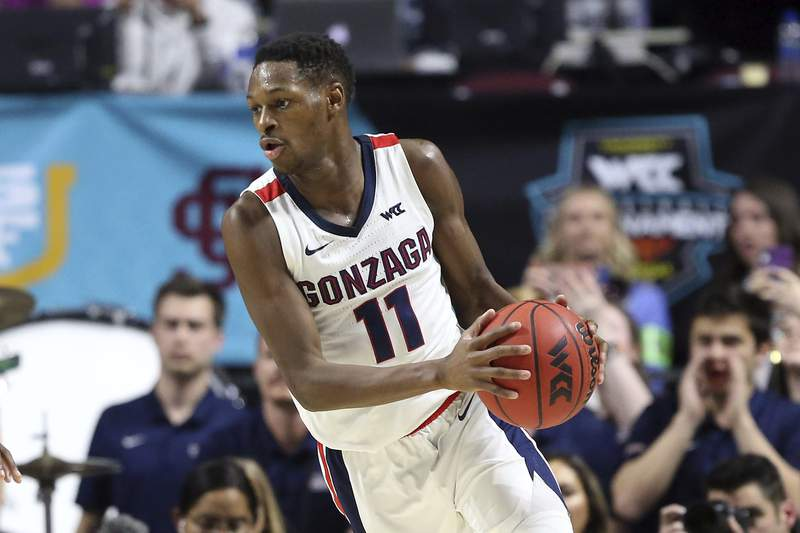 FILE - In this March 9, 2020, file photo, Gonzaga's Joel Ayayi plays against San Francisco during the second half of an NCAA college basketball game in the West Coast Conference men's tournament Monday, in Las Vegas. Ayayi has declared for the NBA draft but says he will not hire an agent. The 6-foot-5 guard from France says his top option remains returning for his junior season.  (AP Photo/Isaac Brekken)