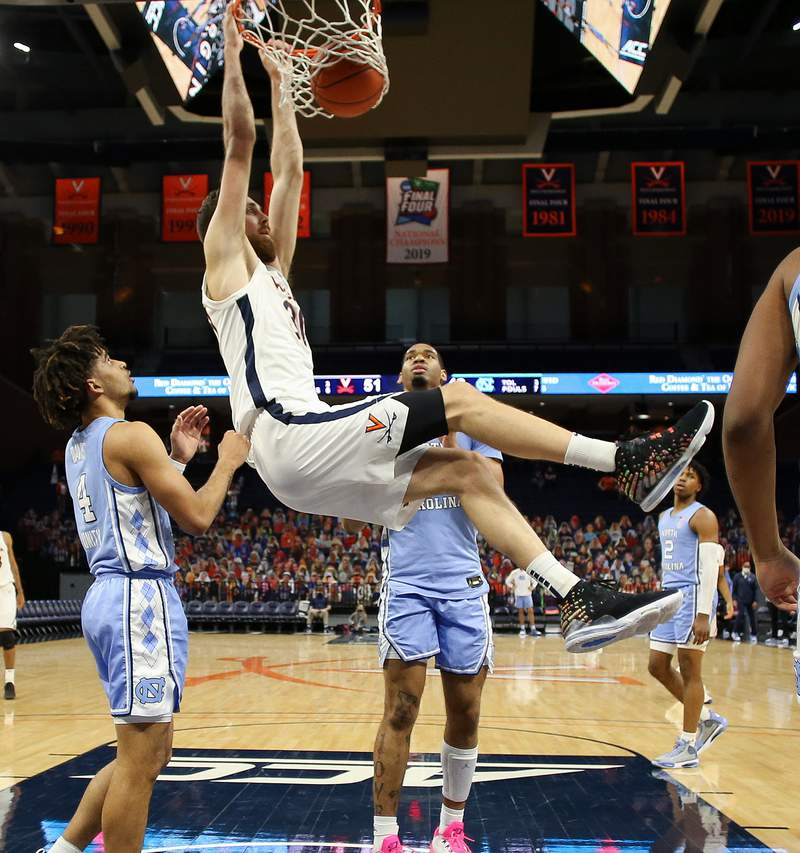 ANDREW SHURTLEFF, THE DAILY PROGRESS Virginia forward Jay Huff (30) dunks the ball after being fouled during the game Saturday in Charlottesville. Virginia defeated North Carolina 60-48.