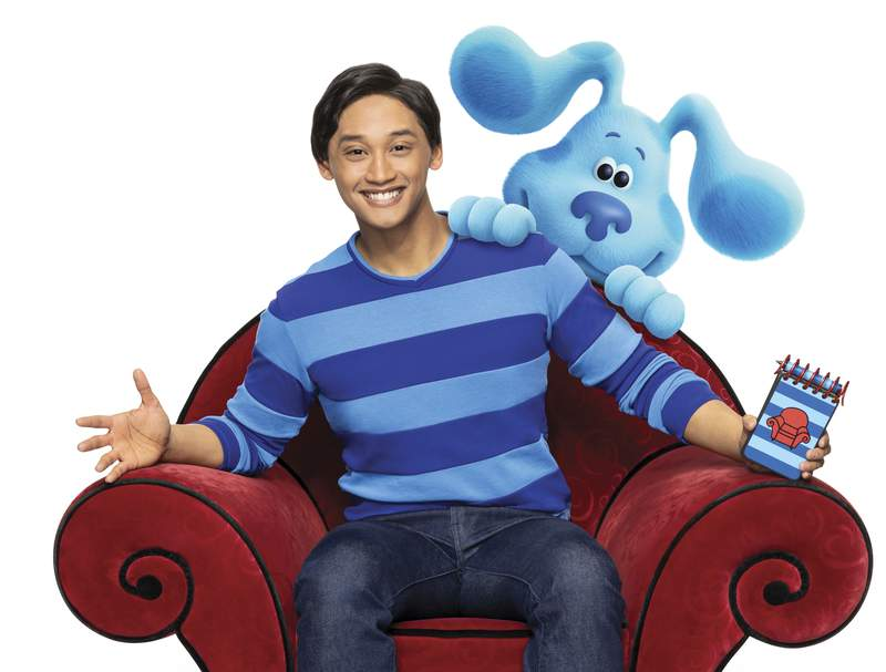 """This undated image released by Nickelodeon shows Joshua Dela Cruz who stars in the reboot of the preschool TV show """"Blue's Clues,"""" called """"Blue's Clues & You!"""" Nickelodeon is celebrating the 25th anniversary of its popular Blues Clues series by commissioning a movie featuring stars of the current reboot, Blues Clues & You. In the movie, Josh and Blue travel to New York City to audition for a Broadway show. (Nickelodeon via AP)"""