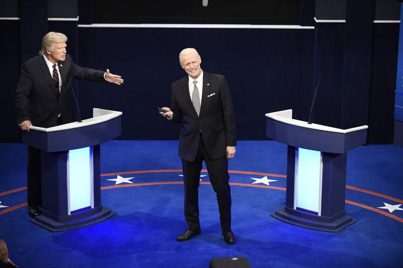 """This image released by NBC shows Alec Baldwin as Donald Trump, left, and Jim Carrey as Joe Biden during the """"First Debate"""" Cold Open on """"Saturday Night Live"""" in New York on Oct. 3, 2020. (Will Heath/NBC via AP)"""