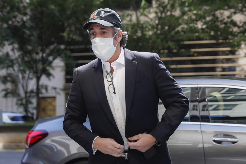 """FILE- In this May 21, 2020 file photo, Michael Cohen arrives at his Manhattan apartment in New York after being furloughed from prison because of concerns over the coronavirus. A bound edition about President Donald Trumps second impeachment will feature a foreword from an estranged associate _ former Trump attorney Michael Cohen. Skyhorse Publishing announced that The Second Impeachment Report"""" comes out Feb. 9. (AP Photo/John Minchillo, File)"""