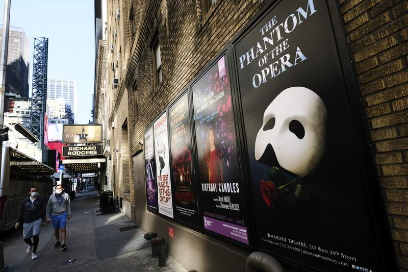 FILE - Broadway posters outside the Richard Rodgers Theatre in New York on May 13, 2020.  Broadway theaters may be dark but there will be plenty of new online productions of some of classic plays this fall. Hamilton producer Jeffrey Richards on Wednesday unveiled a seven weekly play run of livestreamed works to benefit The Actors Fund. They will stream on Broadways Best Shows and ticket buyers can access the events through TodayTix starting at $5. The plays include The Best Man, This Is Our Youth, Time Stands Still and Race (Photo by Evan Agostini/Invision/AP, File)