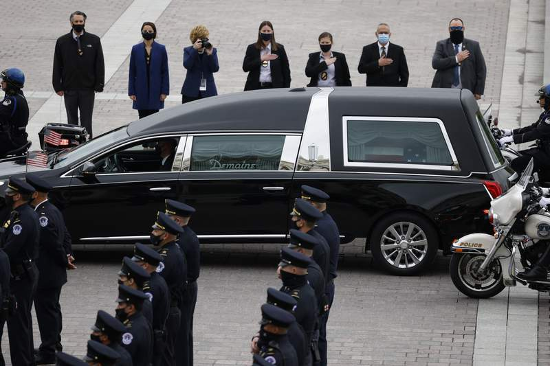A hearse carrying the casket of slain U.S. Capitol Police officer William Billy Evans arrives at the Capitol, Tuesday, April 13, 2021 in Washington. (Carlos Barria/Pool via AP)