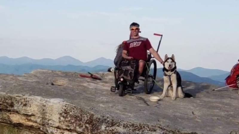 Man reaches top of McAfee's Knob in a wheelchair