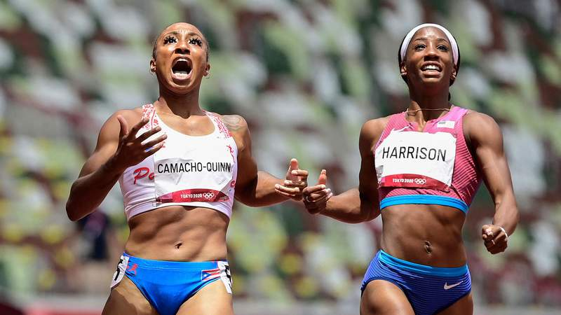 Puerto Rico's Jasmine Camacho-Quinn (L) wins ahead of USA's Kendra Harrison in the women's 100m hurdles final during the Tokyo 2020 Olympic Games at the Olympic Stadium in Tokyo on August 2, 2021. (Photo by Javier SORIANO / AFP) (Photo by JAVIER SORIANO/AFP via Getty Images)