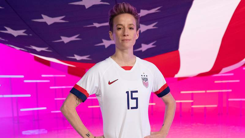 Megan Rapinoe hoisted an imaginary American flag as she and USWNT teammate Abby Dahlkemper staged a Parade of Nations from their team hotel.