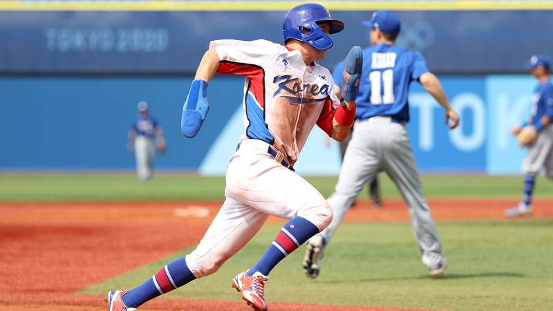 Park Hae-Min of South Korea runs home in the fifth inning against Israel during the knockout stage the Olympic baseball tournament.