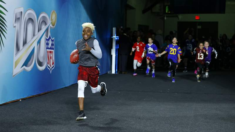 "Maxwell ""Bunchie"" Young runs on the field prior to Super Bowl LIV. (Photo by Kevin C. Cox/Getty Images)"