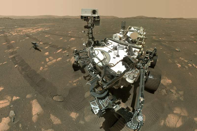 FILE - This Tuesday, April 6, 2021 image made available by NASA shows the Perseverance Mars rover, foreground, and the Ingenuity helicopter about 13 feet (3.9 meters) behind. This composite image was made by the WASTON camera on the rover's robotic arm on the 46th Martian day, or sol, of the mission. On Friday, Aug. 6, 2021, NASAs newest Mars rover came up empty in its first attempt to pick up a rock sample to eventually be brought back to Earth. (NASA/JPL-Caltech/MSSS via AP)