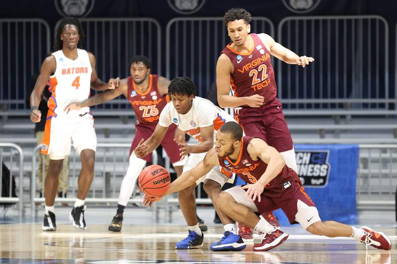 INDIANAPOLIS, INDIANA - MARCH 19: Wabissa Bede #3 of the Virginia Tech Hokies and Tyree Appleby #22 of the Florida Gators fight for possession of the ball in the first half in the first round game of the 2021 NCAA Men's Basketball Tournament at Hinkle Fieldhouse on March 19, 2021 in Indianapolis, Indiana. (Photo by Andy Lyons/Getty Images)