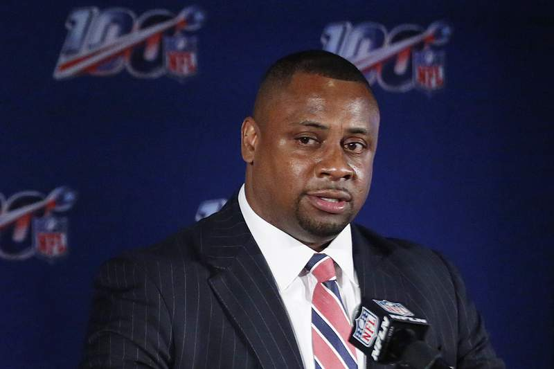 """FILE - In this May 22, 2019, file photo, Troy Vincent, NFL executive vice president, speaks to the media during the owners meetings in Key Biscayne, Fla.  The NFL is planning to play a full season though its uncertain what that will look like.  """"The schedule will come out as normal, but were doing reasonable and responsible planning as we always do, inside of game operations, league executive Troy Vincent told The Associated Press on Thursday, April 30, 2020. (AP Photo/Brynn Anderson, File)"""