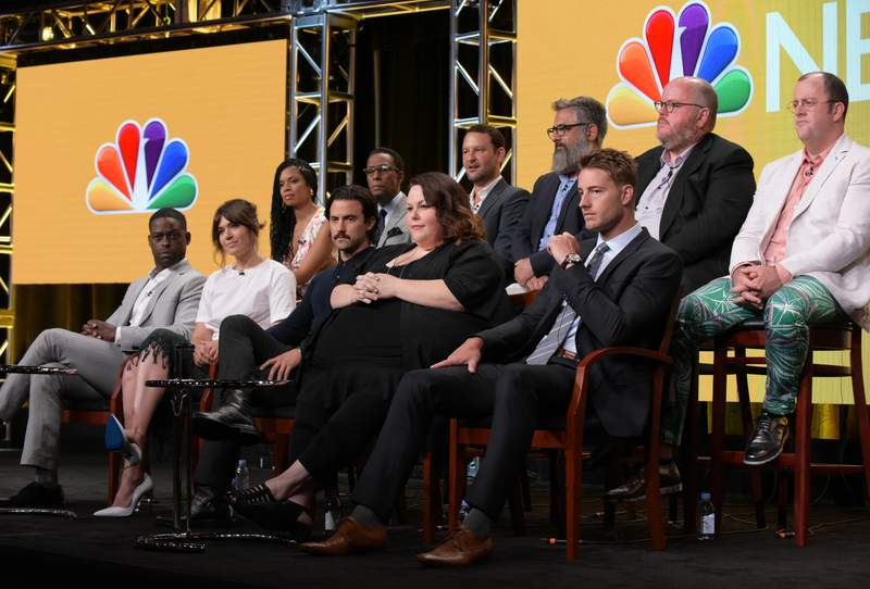 """Susan Kelechi Watson, back row from left, Ron Cephas Jones, creator/executive producer Dan Fogelman, executive producers Glenn Ficarra and John Requa and Chris Sullivan, and front row from left, Sterling K. Brown, Mandy Moore, Milo Ventimiglia, Chrissy Metz and Justin Hartley participates in the """"This Is Us"""" panel during the NBC Television Critics Association summer press tour on Tuesday, Aug. 2, 2016, in Beverly Hills, Calif. (Photo by Richard Shotwell/Invision/AP)"""