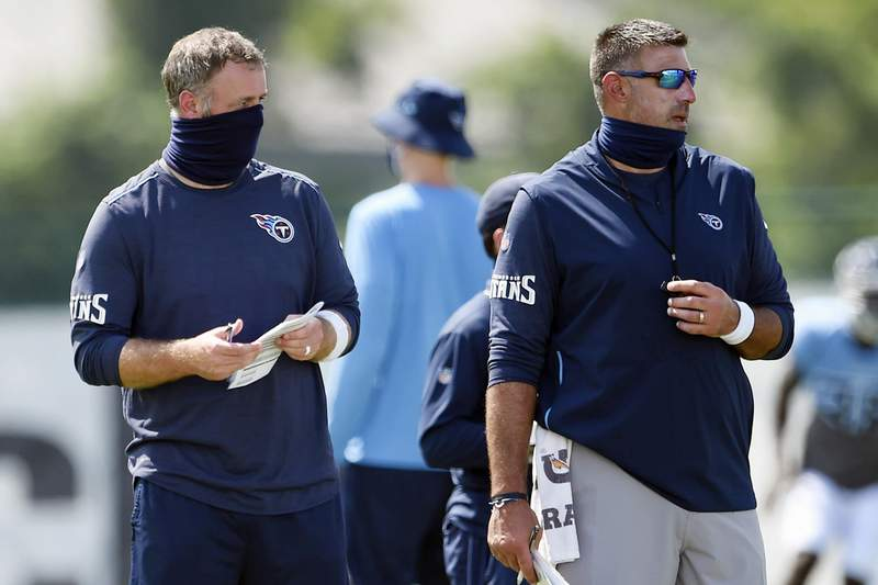 FILE - In this Aug. 24, 2020, file photo, Tennessee Titans outside linebackers coach Shane Bowen, left, and head coach Mike Vrabel watch players during NFL football training camp in Nashville, Tenn. The NFL and the NFL Players Association found instances when the Titans failed to wear masks at all times and were insufficiently clear to players about not meeting or working out once the facility closed in a review given to the team Monday, Oct. 19, 2020, a person familiar with the investigation told The Associated Press.But the person familiar with the review says there was no discussion of any discipline for an individual including general manager Jon Robinson, coach Mike Vrabel or any players, and there was no discussion of punishment, including forfeitures or draft picks. (George Walker IV/The Tennessean via AP, Pool, File)