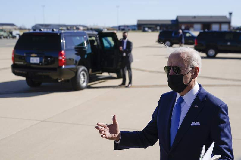 President Joe Biden speaks with members of the press near a waiting motorcade vehicle after stepping off Air Force One at Delaware Air National Guard Base in New Castle, Del., Friday, March 26, 2021. Biden is spending the weekend at his home in Delaware. (AP Photo/Patrick Semansky)