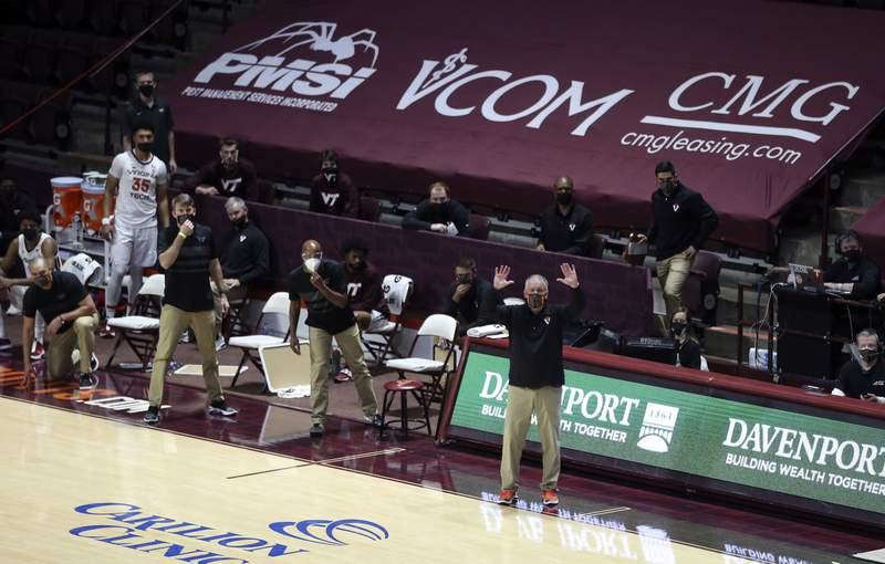Virginia Tech head coach Mike Young coaches from the bench in the second half of the Virginia Tech - Virginia Military Institute NCAA basketball game in Blacksburg Va. Thursday December 3 2020. Virginia Tech won the game 64-57. (AP Photo /  MATT GENRTY, The Roanoke Times, Pool)