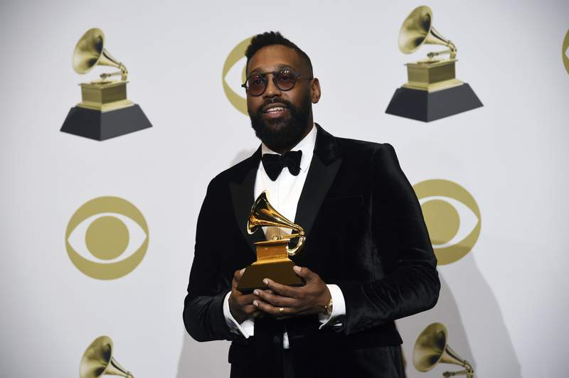 """FILE - In this Jan. 26, 2020 file photo, PJ Morton poses in the press room with the award for best R&B song for """"Say So"""" at the 62nd annual Grammy Awards at the Staples Center in Los Angeles.  Morton is the first artist in residence at a historically Black private university in New Orleans. Dillard University announced that Morton will teach master classes in songwriting, music publishing, studio production and talent management during the 2021-22 academic year.  .(AP Photo/Chris Pizzello, File)"""