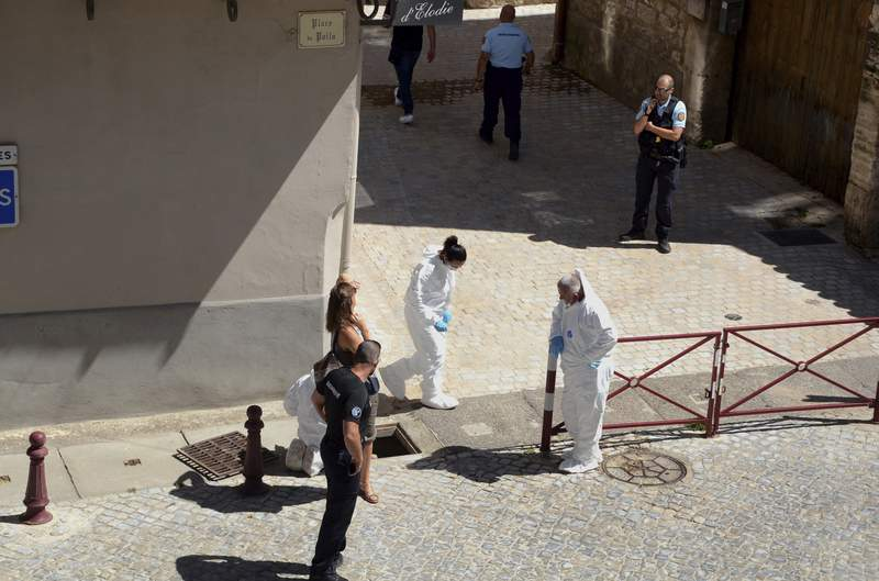 French police stand next a storm drain where the body of Laure Bardina-Kruger was found, in Peyriac de Mer, southern France, Friday, July 24, 2020. A French-American man from Brooklyn was in custody Sunday after he told police that he twice stabbed his wife whose body was found in a storm drain, a local newspaper reported. La Dpche du Midi named the man as Billy Kruger and said he was detained Friday as he was preparing to fly from Toulouse. (AP Photo/Christophe Barreau)