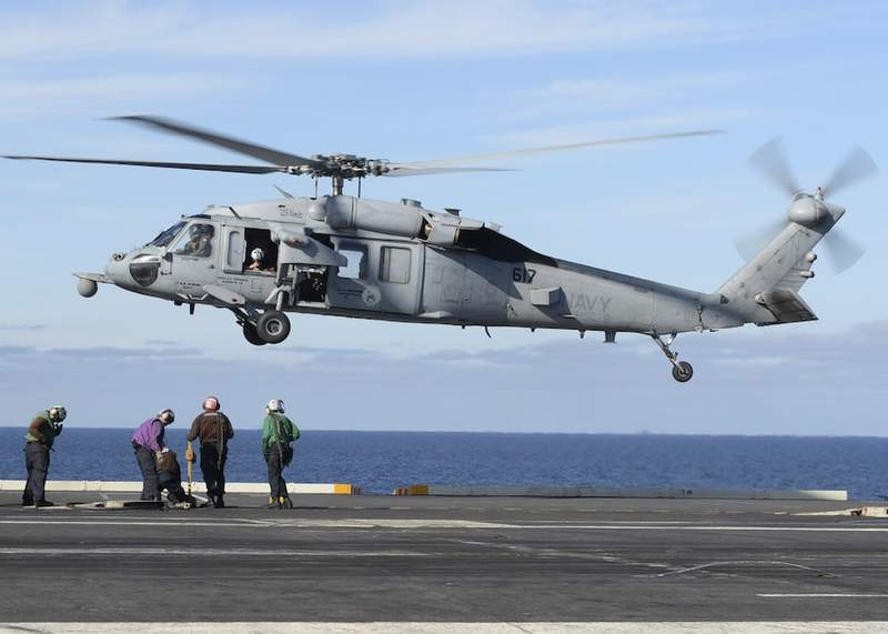FILE - In this March 19, 2017, file photo, released by the U.S. Navy, an MH-60S Sea Hawk helicopter prepares to land on the flight deck of the aircraft carrier USS Nimitz in the Pacific Ocean. The remains of five people and the wreckage of a U.S. Navy helicopter that crashed in the Pacific Ocean off California have been recovered, the Navy said in a statement Tuesday, Oct. 12, 2021. An MH-60S helicopter, similar to the one pictured, its two pilots and three other sailors were lost in an Aug. 31 accident about 69 miles (111 kilometers) off the San Diego coast. (Mass Communication Specialist Seaman Ian Kinkead/U.S. Navy via AP, File)