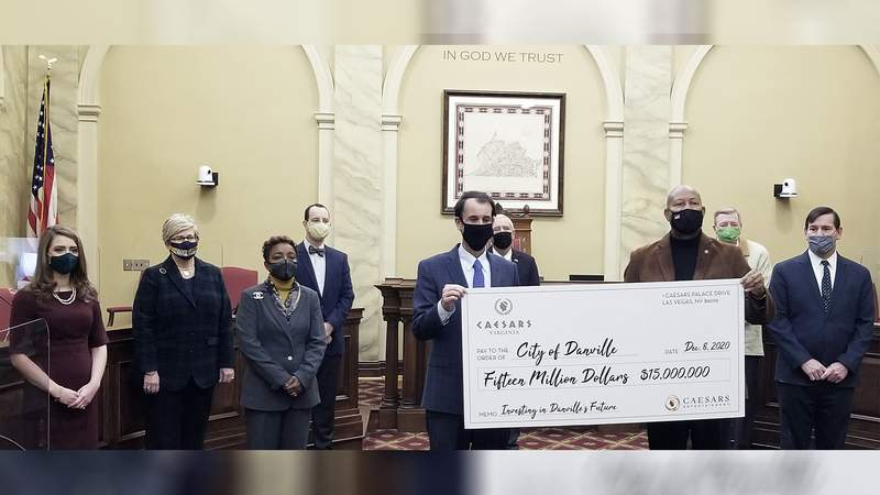 Caesars Virginia presents the city of Danville with a $15 million check on Dec. 8, 2020.