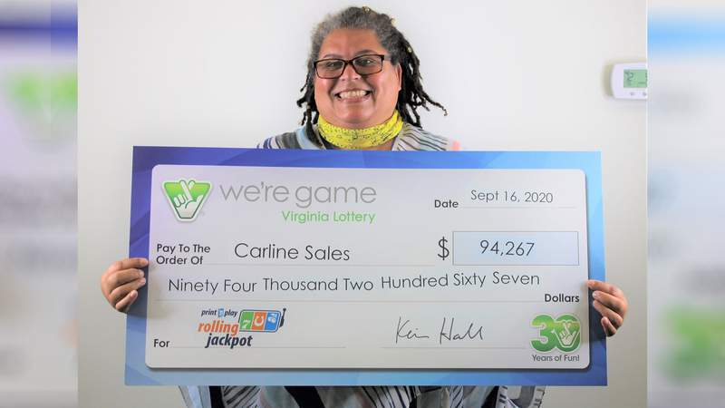 Carline Sales with her lottery winning check