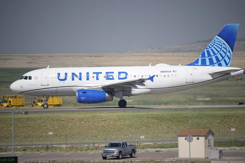 FILE - A United Airlines jetliner taxis down a runway for take off from Denver International Airport Friday, July 2, 2021, in Denver. United Airlines reduced its quarterly loss to $434 million and posted surprisingly strong revenue as U.S. vacation travel picked up. In reporting its second-quarter results Tuesday, July 20, 2021 the Chicago-based airline said it expects to earn a pretax profit in the remaining two quarters of the year. That would break a string of six-straight money-losing quarters since the pandemic began to crush air travel. (AP Photo/David Zalubowski, file)