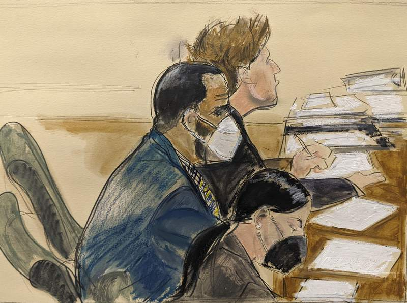 """In this courtroom artist's sketch R. Kelly, left, listens during his trial in New York, Thursday, Aug. 26, 2021. The 54-year-old Kelly has repeatedly denied accusations that he preyed on several alleged victims during a 30-year career highlighted by his mega hit """"I Believe I Can Fly.""""(AP Photo/Elizabeth Williams)"""