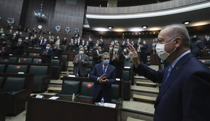 """Turkey's President Recep Tayyip Erdogan arrives to address the lawmakers of his ruling party at the parliament, in Ankara, Turkey, Wednesday, Nov. 11, 2020. Erdogan said a memorandum of understanding was signed earlier on Wednesday toward the creation of a joint Turkish-Russian peacekeeping center in Azerbaijani territories that were """"liberated from occupation."""" (Turkish Presidency via AP, Pool)"""