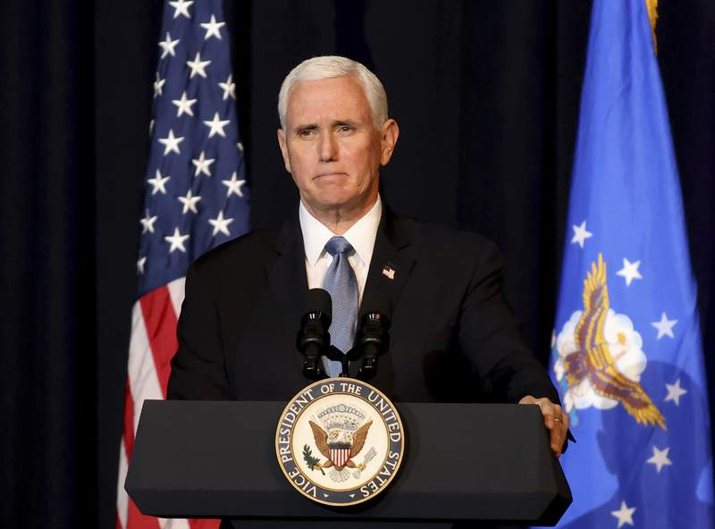 FILE - Vice President Mike Pence speaks during a memorial service for the late Air Force Brig. Gen. Chuck Yeager in Charleston, W. Va., on  Jan. 15, 2021. Pence has a book deal. His autobiography, currently untitled, is scheduled to come out in 2023. (AP Photo/Chris Jackson, File)