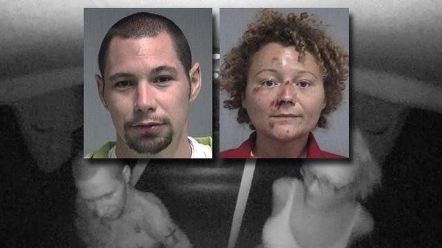 Nassau County Sheriff's Office booking photos of Aaron Thomas and Megan Mondanaro shown on an image taken from the cruiser's dashcam video.