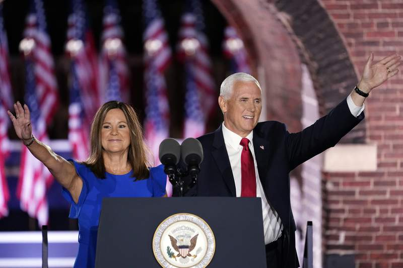 Vice President Mike Pence arrives with his wife Karen Pence to speak on the third day of the Republican National Convention at Fort McHenry National Monument and Historic Shrine in Baltimore, Wednesday, Aug. 26, 2020. (AP Photo/Andrew Harnik)