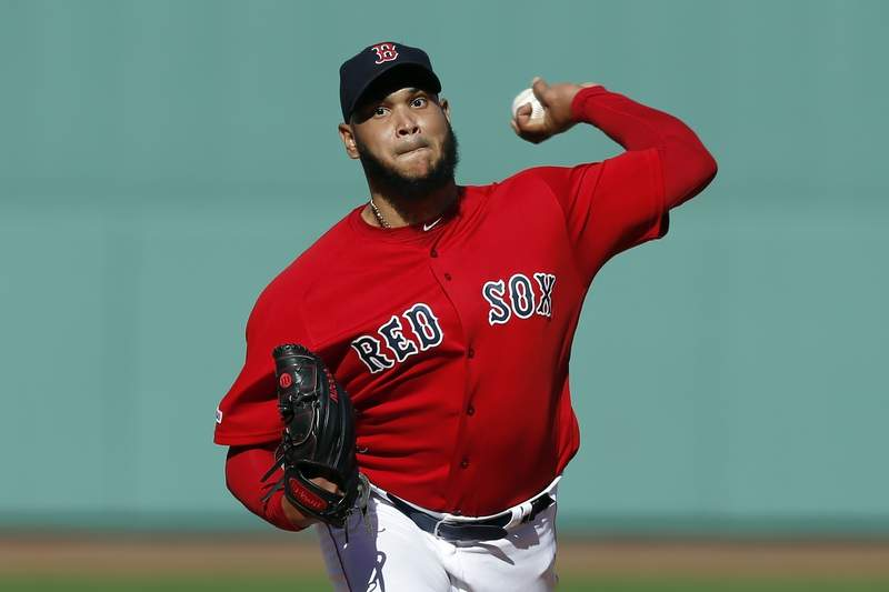 FILE - In this Sept. 29, 2019, file photo, Boston Red Sox's Eduardo Rodriguez pitches during the first inning of a baseball game against the Baltimore Orioles in Boston. Rodrguez will miss the entire season because of heart inflammation caused by COVID-19. He has been on the injured list since mid-July and has not pitched this season. (AP Photo/Michael Dwyer, File)