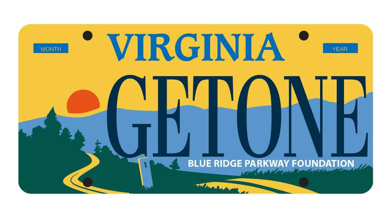 The proposed plate entails a road winding through a nature setting with the Blue Ridge Mountains in the background as the sun illuminates the sky.