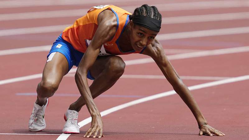 Sifan Hassan gets up after falling to the track in the women's 1500m preliminaries Monday at the Tokyo Olympics.