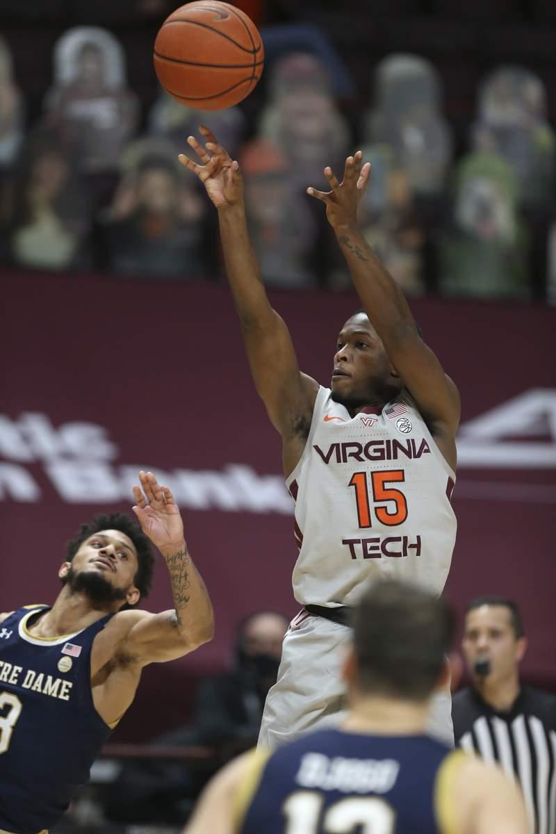 Virginia Tech's Jalen Cone 15 shoots a 3-point basket in the second half of an NCAA college basketball game in Blacksburg, Va., Sunday January10 2021. Virginia Tech won the game 77-63. (Matt Gentry/The Roanoke Times via AP, Pool)