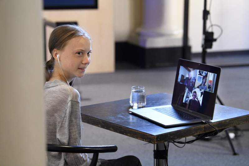Environmental activist Greta Thunberg talks via video link with Professor of Environmental Science Johan Rockstrom in Germany, during a live chat on International Earth Day where they discussed the coronavirus pandemic and the environment, at the Nobel Museum in Stockholm, Sweden, Wednesday, April 22, 2020. (Jessica Gow/TT News Agency via AP)