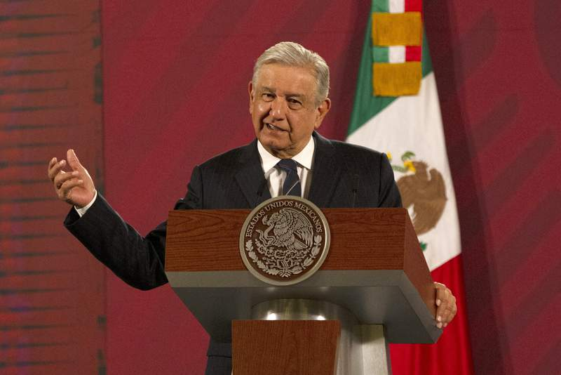 Mexican President Andres Manuel Lopez Obrador gives his daily, morning news conference at the presidential palace, Palacio Nacional, in Mexico City, Friday, Oct. 16, 2020. Lpez Obrador said Friday that his ambassador to the United States told him two weeks ago that there was an investigation underway there involving Mexico's former defense secretary, retired Gen. Salvador Cienfuegos, who was arrested Thursday in Los Angeles. (AP Photo/Marco Ugarte)