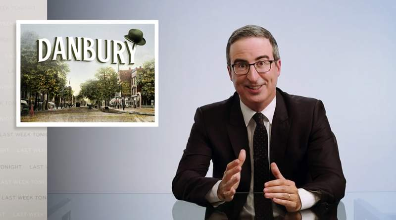 "This video frame grab shows John Oliver from his ""Last Week Tonight with John Oliver"" program on HBO, Sunday, Aug. 30, 2020. On Aug. 22,  Danbury, Conn., Mayor Mark Boughton announced a tongue-in-cheek move posted on his Facebook page to rename Danbury's local sewage treatment plant after Oliver following the comedian's expletive-filled rant about the city. Oliver then offered to donate $55,000 to charity if the city actually followed through with it. On Thursday, Oct. 8, the Danbury City Council voted 18-1 to rename the sewage plant after the comedian. (HBO via AP)"