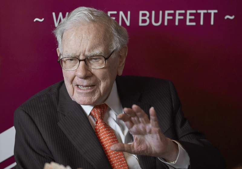 FILE - In this May 5, 2019, file photo Warren Buffett, Chairman and CEO of Berkshire Hathaway, speaks during a game of bridge following the annual Berkshire Hathaway shareholders meeting in Omaha, Neb.  Buffett said, Wednesday, June 30, 2021,  the economic impact of the pandemic remains hard to predict but most big companies have fared OK throughout it as long as they weren't tied to travel.   (AP Photo/Nati Harnik, File)