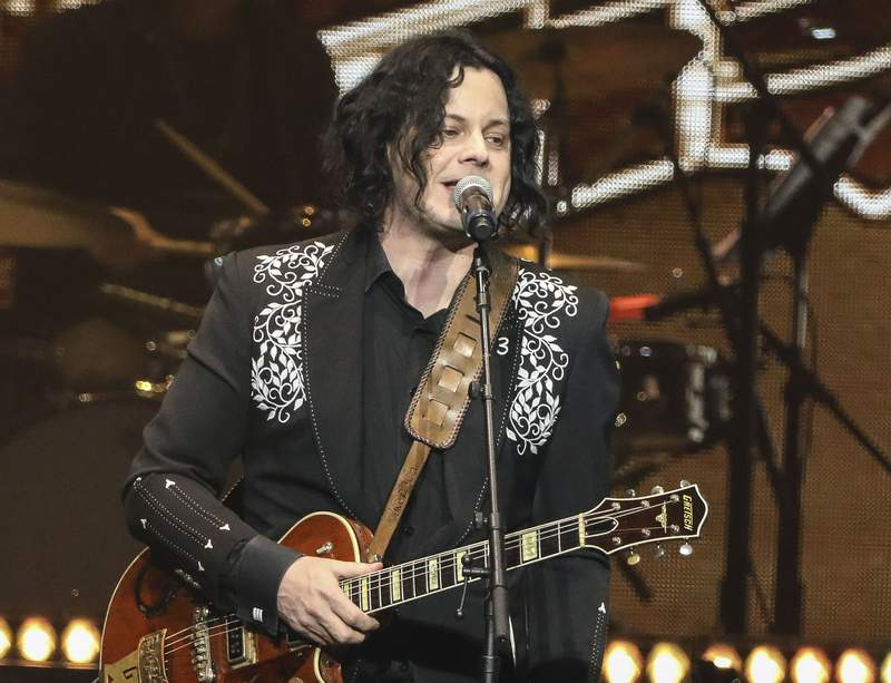 FILE - This April 1, 2019 file photo shows Jack White performing at Loretta Lynn's 87th Birthday Tribute in Nashville, Tenn. White will be the last-minute replacement musical guest on Saturday Night Live after country singer Morgan Wallen was dropped for breaking COVID-19 protocols. Lorne Michaels made the announcement Friday on the Today show. (Photo by Al Wagner/Invision/AP, File)