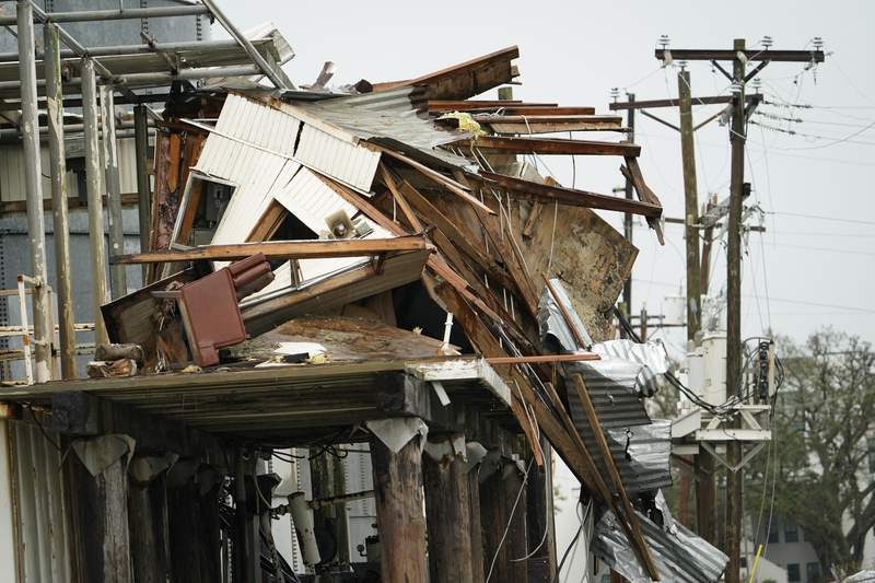 Flooding surrounds a damaged building Friday, Aug. 28, 2020, in Cameron, La., after Hurricane Laura moved through the area Thursday. (AP Photo/David J. Phillip)