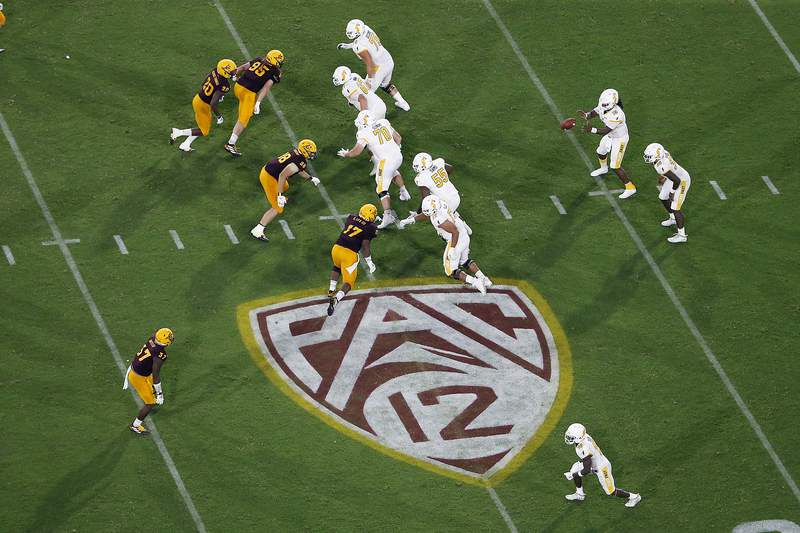 FILE - This Thursday, Aug. 29, 2019, file photo, shows the Pac-12 logo during the second half of an NCAA college football game between Arizona State and Kent State, in Tempe, Ariz. The Pac-12 has set Sept. 26 as the start of its 10-game conference-only football schedule. The Pac-12 announced three weeks ago it would eliminate nonconference games for its 12 member schools. (AP Photo/Ralph Freso, File)