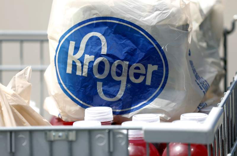 In this June 15, 2017, file photo, bagged purchases from a Kroger grocery store sit in a shopping cart in Flowood, Miss. (AP Photo/Rogelio V. Solis, File)