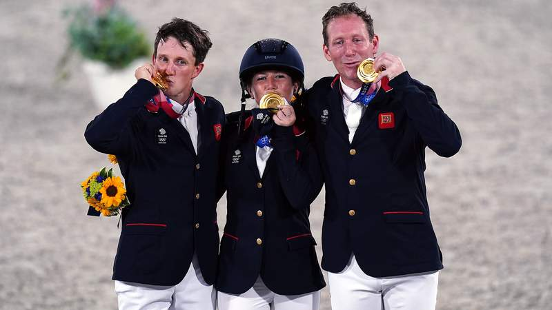 Great Britain's Laura Collett, Tom McEwen and Oliver Townend with their gold medals for the Eventing Jumping Team Final during the Eventing Jumping Team Final and Individual Qualifier at Equestrian Park on the tenth day of the Tokyo 2020 Olympic Games in Japan.