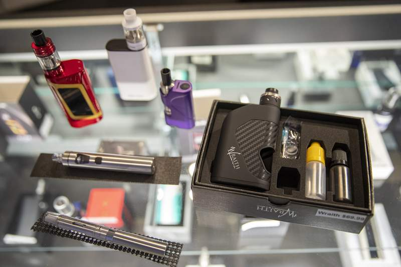 FILE - In this Thursday, Jan. 2, 2020 file photo, vaping devices are displayed at a store in New York. On Thursday, April 23, 2020, the U.S. Food and Drug Administration said that a federal court accepted its request to push back the May 12 deadline to submit vaping product applications to Sept. 9. The agency said the COVID-19 pandemic has delayed preparations to meet the deadline for both companies and FDA staff. (AP Photo/Mary Altaffer)