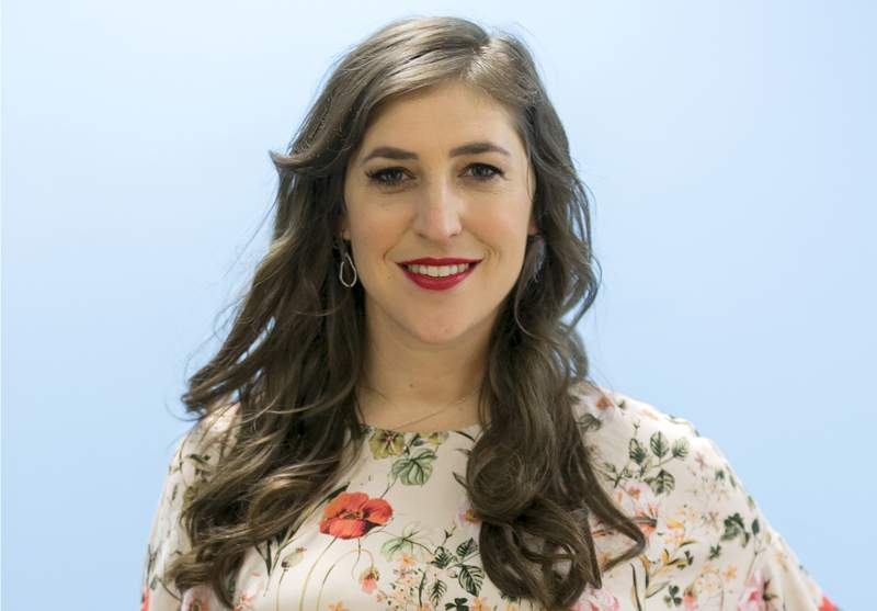 """FILE - In this May. 23, 2017 file photo, Mayim Bialik poses for a photo in Los Angeles. """"Jeopardy!"""" is back to guest hosts after the resignation of new host Mike Richards, and actor Mayim Bialik will return as the first. Sony Pictures Television announced Monday that Bialik will take the podium for three weeks of episodes. (AP Photo/Damian Dovarganes)"""