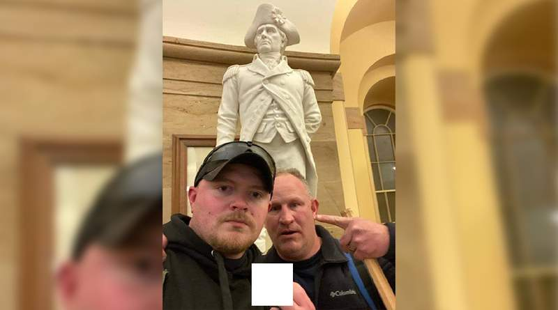 Photo surfaces showing two Rocky Mount police officers inside Capitol on Wednesday, Jan. 6, 2021.