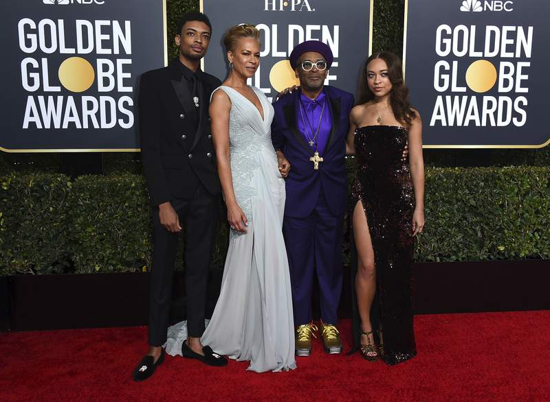 FILE - Director Spike Lee, second right, and his family, from left, son Jackson Lee, wife Tonya Lewis Lee and daughter Satchel Lee, right, arrive at the 76th annual Golden Globe Awards in Beverly Hills, Calif. on  Jan. 6, 2019. Lees daughter and son have been chosen as the Golden Globe ambassadors to assist with the awards ceremony. The Hollywood Foreign Press Association announced Tuesday, Jan. 12, 2021, that Satchel and Jackson Lee will assume the ambassador roles for the 78th annual Golden Globes Awards in February. (Photo by Jordan Strauss/Invision/AP, File)